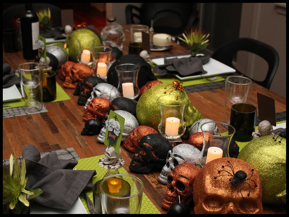 Skulls in four different colors adorn the center of the table.